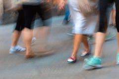 Movement of pedestrians on the sidewalk Stock Image