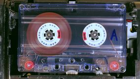 Movement of reels with magnetic tape in an old audio cassette. stock video