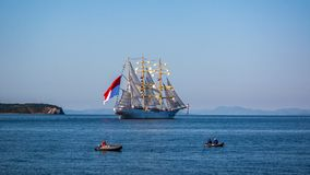 The movement of sailing ship ?aiwo Maru in the Amur Bay of the Bosporus Easern strait near the Russian Island during the preparati royalty free stock images