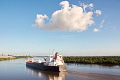 The movement of sea merchant ships and tugs to the entrance and exit from the port. Beaumont, Texas royalty free stock photo