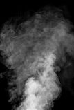 Movement of smoke with background is dark. Royalty Free Stock Images