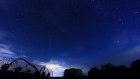 The movement of stars and clouds. Time Lapse stock footage