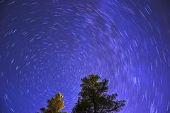 Movement of stars in the night sky. Stock Images