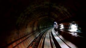 Movement through subway underground tunnel. View through the window of train driver in subway underground tunnel stock video