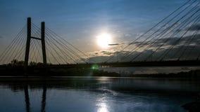 The movement of the sun over the suspension bridge stock video