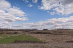 The movement of the thunderclouds over the fields of winter whea. T in early spring in the vast steppes of the Don royalty free stock photo