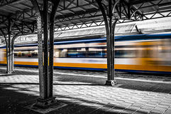Movement. A train leaving a station in the Netherlands Royalty Free Stock Photo