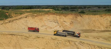 The movement of trucks in career. POLEWOJE, KALININGRAD REGION, RUSSIA — JUNE 18, 2014: The movement of trucks in career Stock Photography