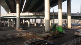 Movement under modern overpasses. Moscow stock video