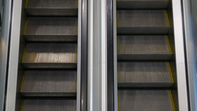 Movement up and down escalators stock video footage