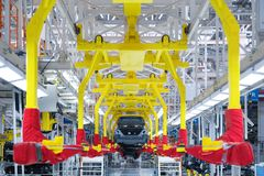 Movement of vehicles along the production line at the plant. Car Assembly shop. Car Assembly by parts. Modern automobile production line, automated production stock photos