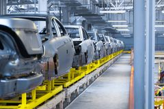 Movement of vehicles along the production line at the plant. Car Assembly shop. Car Assembly by parts. Modern automobile production line, automated production royalty free stock photo