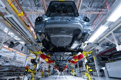 Movement of vehicles along the production line at the plant. Car Assembly shop. Car Assembly by parts. Modern automobile production line, automated production royalty free stock image