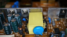 Movement of a view along the capacitors and transistors stock video footage