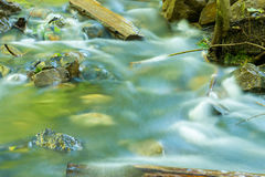 The movement of water in forest stream shot with long exposure Stock Images