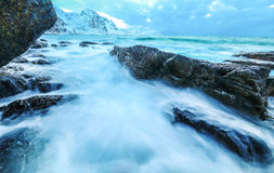 Movement of water on the shores of cold Norwegian Sea at evening time. Lofoten islands. Beautiful Norway landscape. Royalty Free Stock Image