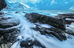 Movement of water on the shores of cold Norwegian Sea at evening time. Lofoten islands. Beautiful Norway landscape. Stock Images