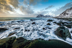 Movement of water on the shores of cold Norwegian Sea at evening time. Lofoten islands. Beautiful Norway landscape. Stock Image