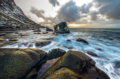 Movement of water on the shores of cold Norwegian Sea at evening time. Lofoten islands. Beautiful Norway landscape. Stock Photography