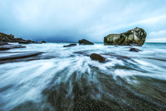 Movement of water on the shores of cold Norwegian Sea at evening time. Lofoten islands. Beautiful Norway landscape. Royalty Free Stock Photos