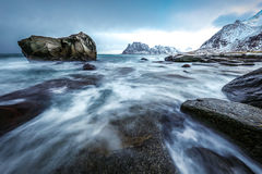 Movement of water on the shores of cold Norwegian Sea at evening time. Lofoten islands. Beautiful Norway landscape. Royalty Free Stock Photo
