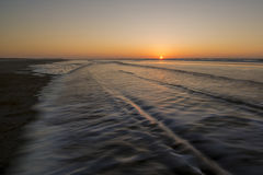Movement of waves on beach. Movement of waves on the beach at sunset Royalty Free Stock Images