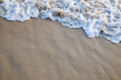 The movement of the waves on the sand is smooth and fine for  ba. Ckground Royalty Free Stock Images