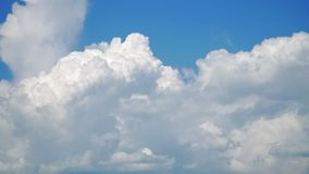 The movement of white clouds against a blue sky. Timelapse stock video