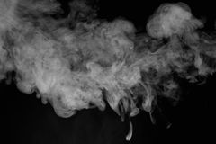 Movement of white smoke. Smoke isolated on black background. Movement of white smoke Royalty Free Stock Photography
