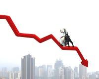 Movendo o símbolo do dinheiro em ir abaixo da seta Imagens de Stock