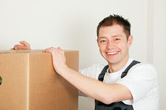 Mover with boxes in the course of relocation Stock Photo