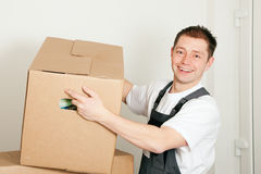 Mover with boxes in the course of relocation Royalty Free Stock Photos