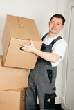 Mover with boxes in the course of relocation Stock Images