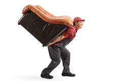 Mover carrying an armchair on his back royalty free stock image