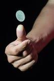 Mover de un tirón una moneda Imagen de archivo