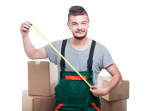 Mover guy with boxes around showing ruler tape. Isolated on white background Stock Image