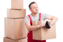 Mover guy holding box and checking his wallet Royalty Free Stock Images