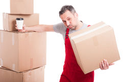 Mover guy holding box and coffee cup taking a break Royalty Free Stock Images