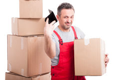 Mover guy holding box and throwing his empty wallet Royalty Free Stock Image