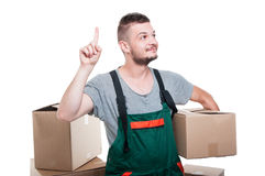 Mover guy holding cardboard box gesturing idea Royalty Free Stock Images