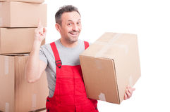 Mover guy holding cardboard box making great idea gesture Royalty Free Stock Image