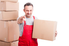 Mover guy holding cardboard box and pointing camera. Looking confident isolated on white background with copy text space Stock Images