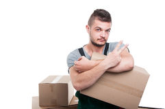 Mover guy holding cardboard box showing number two Royalty Free Stock Photo