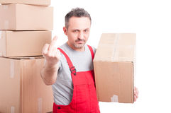 Mover guy holding cardboard box showing obscene gesture. Looking mad or angry isolated on white background with copy text space Stock Images