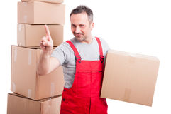 Mover guy holding cardboard box using invisible touch screen Stock Photos