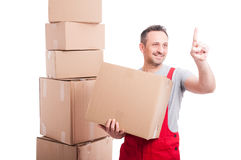 Mover guy holding cardboard box using invisible touch screen Stock Image
