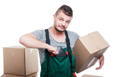 Mover guy putting out his wallet holding box Royalty Free Stock Image