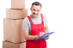Mover guy smiling and counting or writing on clipboard stock photos