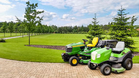 Mover after lawn-mowing spacious garden Royalty Free Stock Image