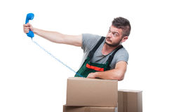 Mover man holding away phone receiver. Like someone screaming isolated on white background Stock Image